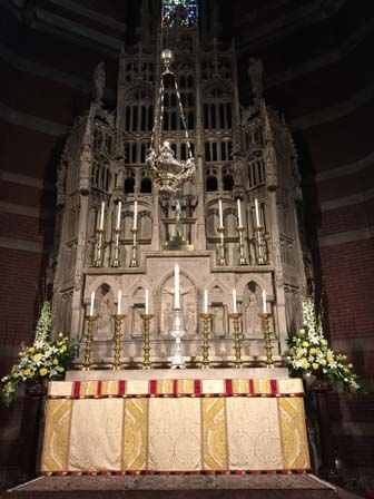 the High Altar with a seventh candle, signifying the presence of the Ordinary