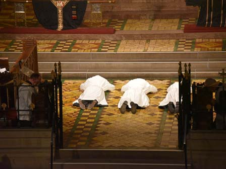 sacred ministers prostrate before the altar