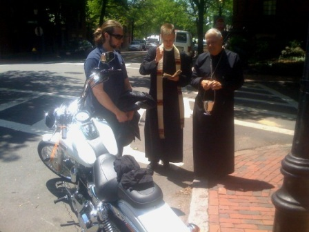 Fr Gray blessing a motorcycle