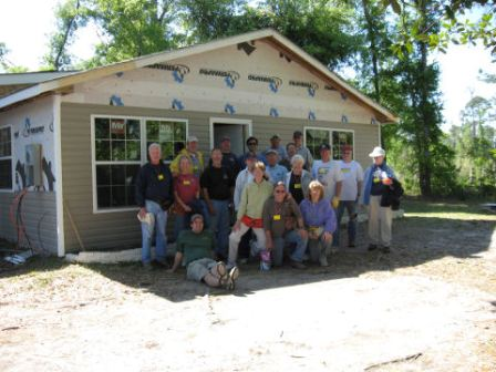 crew in front of rebuilt house