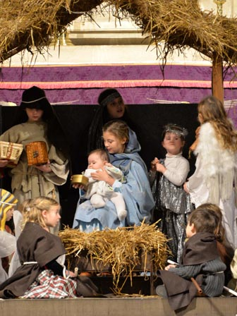 Magi, angels and shepherds at the manger